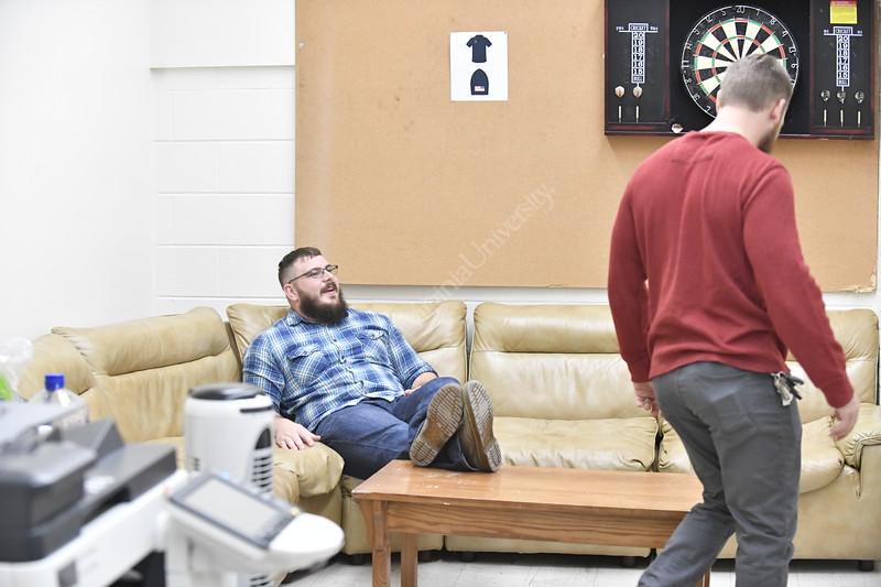 Ed Olesh poses for photographs in the Veteran Lounge in Percival hall for the Davis College Alumni Magazine November 16th, 2017.  Photo Brian Persinger