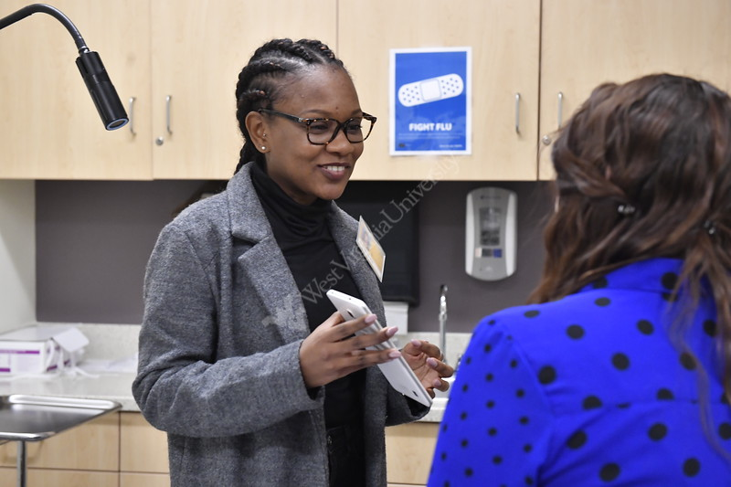 Students from the School of Public Healths' Academic Ambassadors program conduct patient focused public health research at the WVU Suncrest Urgent Care facility November 29th, 2017.  Photo Brian Persinger