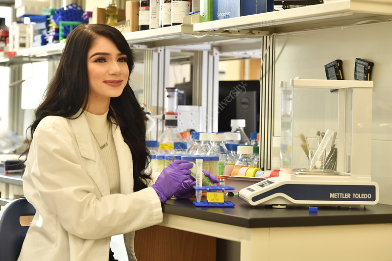 Marissa Frazie an undergraduate student at WVU's Davis college poses for an Environmental Portrait in the research lab November 30, 2017. Photo Greg Ellis