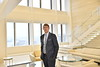 WVU College of Law graduate Travis Brannon class of 2014 poses in the Pittsburgh Pa. lobby of K&L Gates.  Brannon's specialty is energy and environmental matters with an emphasis on energy litigation. Photo Greg Ellis
