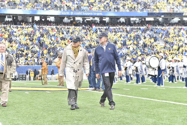 The Mr. and Mrs. Mountaineer finalists march across the football field at halftime as WVU takes on Oklahoma State. Seniors Garret Burgess and Savannah Lusk were announced as winners and congrad