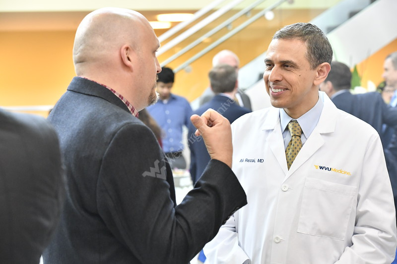 Friends and members of the WVU medical community join together for the Rockefeller Chair Investiture of Dr. Ali Rezai At the HSC April 16, 2018.  Photo Greg Ellis