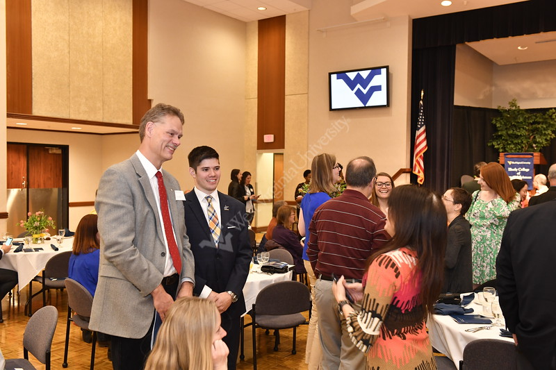 Eberly Arts and Sciences students pose for photographs with Dean Greg Dunaway in the Gold and Blue Ballrooms of the Mountainlair, April 21st, 2018.  Photo Brian Persinger