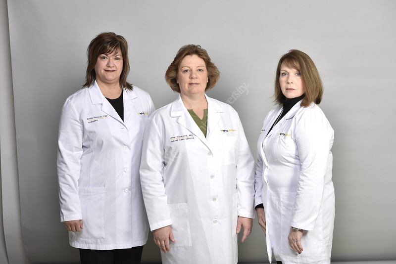 Members of the WVU Medicine Wound Team pose for a photo in the HSC studio April 24, 2018. Photo Greg Ellis