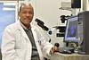 Dr. Yehenew Agazie, associate professor of biochemistry in the WVU School of Medicine poses for a portrait in his lab April 17, 2018. Photo Greg Ellis