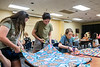 Computer Science major Emil Ogden, Aerospace and Mechanical Engineering major Alisha Rinh and Nursing major Kelsey Hays participate in Project Linus, a program creating blankets to serve sick and traumatized children in the Mountainlair August 12th, 2018.  Project Linus partnered with the Center for Service and Learning and is donating blankets made by the students to WVU Medicine Children's.  Photo Brian Persinger
