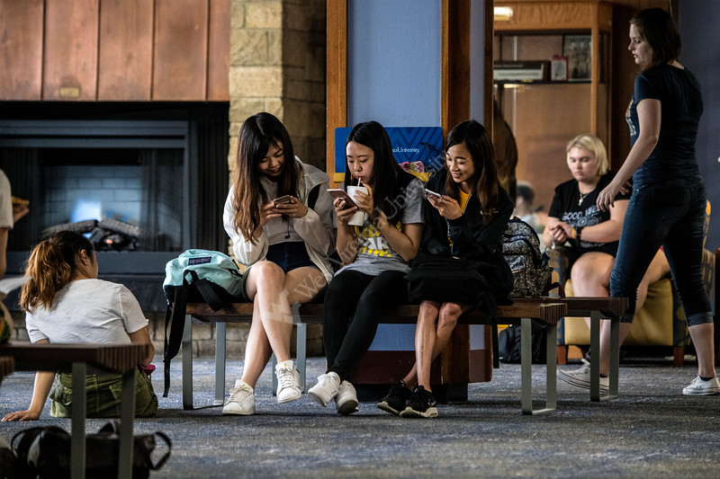 Asako Shiraishi, Rina Kamiya, and Mayu Sakurai relax after the first day of classes in the Vandalia Lounge of the Mountainlair August 15th, 2018.  Photo Brian Persinger
