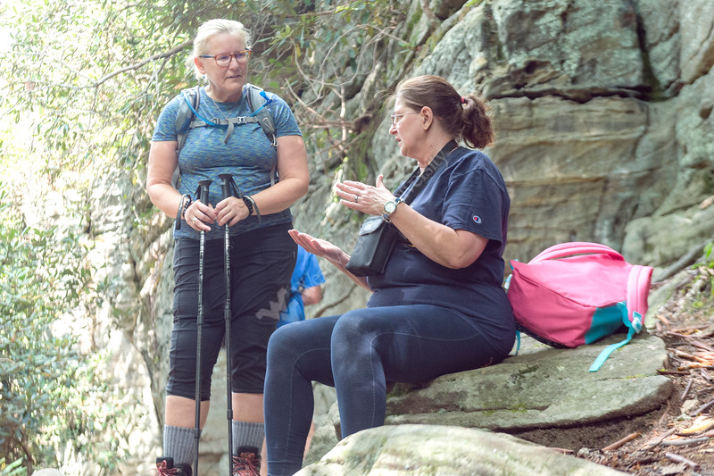 Two veteran students engaged in conversation during a water break at Coopers Rock on Saturday, August 25, 2018. Photo by Hunter Tankersley. The university sponsored event was held to celebrate their return to the campus.