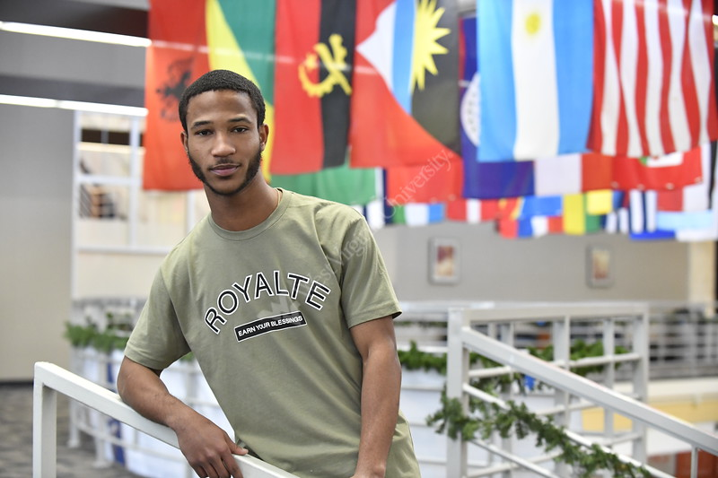 Gilman Scholar winner Demitrus Jones poses for photographs above the grand staircase of the Mountainlair December 12th, 2018.  Photo Brian Persinger