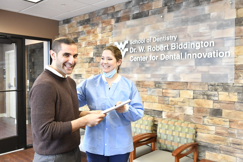 Dr. Laura Yura, the innovation center director and WVU dental students work with equipment sponsored by companies that have made the innovation center possible. January 16, 2018. Photo Greg Ellis.