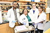 Candice Brown, PhD. Assistant Professor Rockefeller Neuroscience Institute is seen with her students (L to R) Divine Nwafor, an MD/PhD neuroscience student, and Allison Brichacek, a PhD student of immunology and microbial pathogenesis. Sneha Gupta, a second-year School of Medicine student (R) at the Erma Byrd Biomedical Research Building January 29, 2018. Photo Greg Ellis