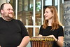 Dr. Travis Stimeling; associate professor of musicology; and Kayla Tokar; a junior music major and Honors student; conduct research in summer 2018 on drumming during America's colonial period when South Carolina passed laws prohibiting enslaved Africans from drumming at the Creative Arts Center July 18th; 2018. One drum represents what European colonists might have used and the other is a djembe; which is similar to what the slaves may have used. Photo Brian Persinger