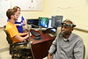 Dr. Kimberly Meigh and Jacob Cohn conduct research in the Speech Pathology Lab of Allen Hall July 23rd, 2018.  Photo Brian Persinger