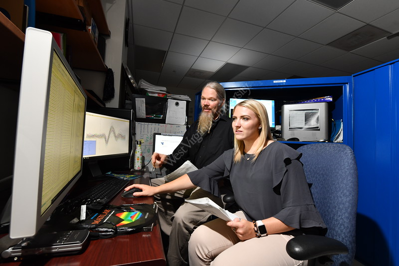 Professor James Lewis and Molly Layne conduct research on vocal sounds and the brain in the Rockefeller Nurosciences Institute at the Health Sciences Center July 24th, 2018.  Photo Brian Persinger