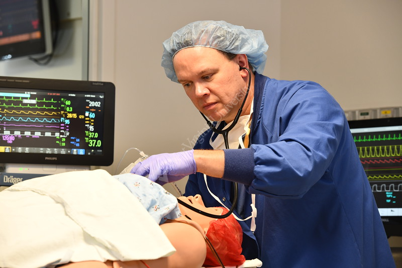 Aaron M. Ostrowski Clinical Assistant Professor, Nurse Director Anesthesia Program poses for photos with the METI simulator in the STEPS lab and at locations on the WVU HSC campus. July 25, 2018. Photo Greg Ellis
