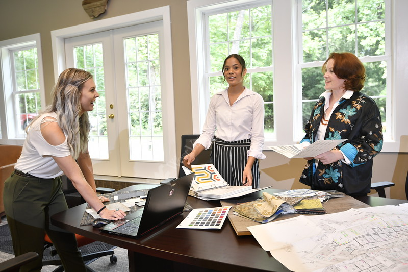 Interior Design students work with their professor at  Omega Commercial Interiors sharing ideas and creating an office space June 7, 2018. Photo Greg Ellis
