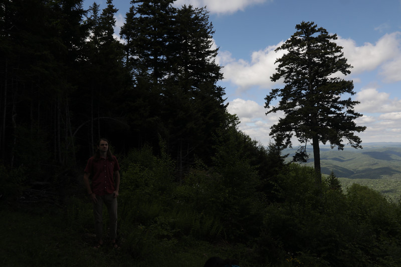 Justin Mathias poses for portrait at Gaudineer Knob, WV.<br /> 34640 WVU Mag Red Spruce Research<br /> WVU Photo/ Raymond Thompson<br /> WVU Magazine