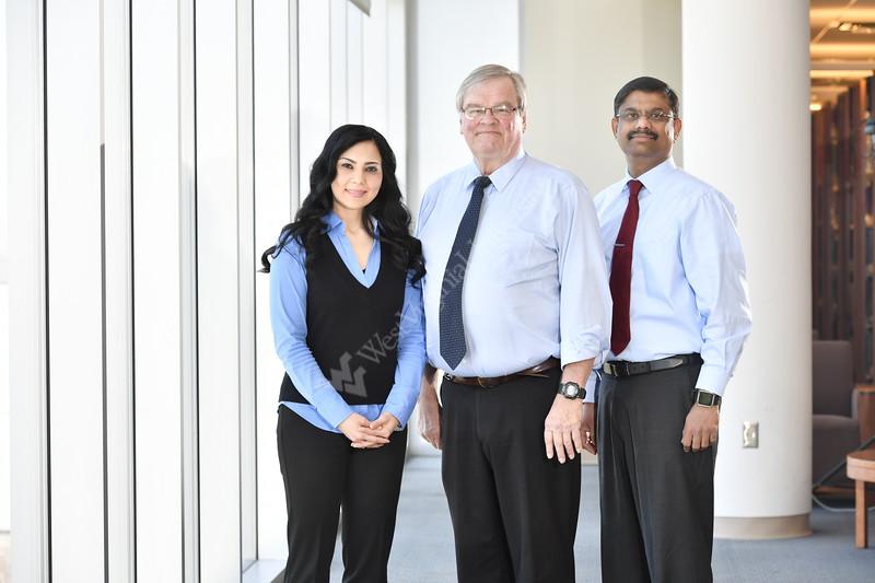 Faculty from the WVU School Of Dentistry (L to R) Hiba Qari Jerry Bouqout Ashok Balasundarak  pose for photos March 5, 2018. Photo Greg Ellis