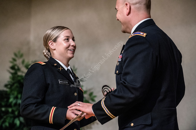 Hannah Macleod a Psychology major receives a sabre during the ARMY ROTC May Commissioning Ceremony in the Mountainlair May 10th, 2018.  Photo Brian Persinger