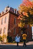 Students walk past Martin Hall on a fall evening.