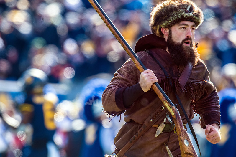 WVU Mountaineer Trevor Kiess leads the Mountaineers onto the field prior to kickoff during the game versus  TCU November 10th, 2018.  Photo Brian Persinger