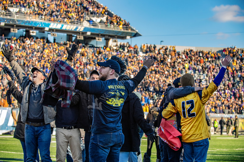 WVU veterans celebrate and sing Country Roads on Mountainer Field after the conclusion of the game versus TCU November 10th, 2018.  Photo Brian Persinger