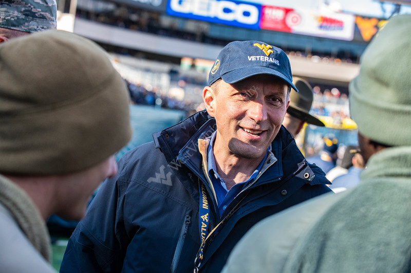Executive Director of the Alumni Association Sean Frisbee talks with Air Force members on the field during the game versus TCU November 10th, 2018.  Photo Brian Persinger