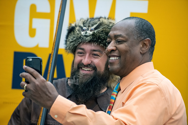 """Associate Vice President for Student Life Michael Ellington poses with Mountaineer Trevor Kiess during the second annual, """"Day of Giving"""" event in the Mountainlair November 14th, 2018.  Photo Brian Persinger"""