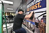 Jani Horvath wraps the wall of the WVU Veteran and Military Family Support Headquarters with military lifestyle scenes. The Support Headquarters located in the WVU Mountain Lair will provide academic and social support to student Veterans and their families. November 26, 2018. Photo Greg Ellis