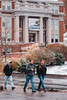 Students walk towards the Mountain Lair on a snowy day.