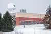 A student walks across the Evansdale campus on a snowy day.