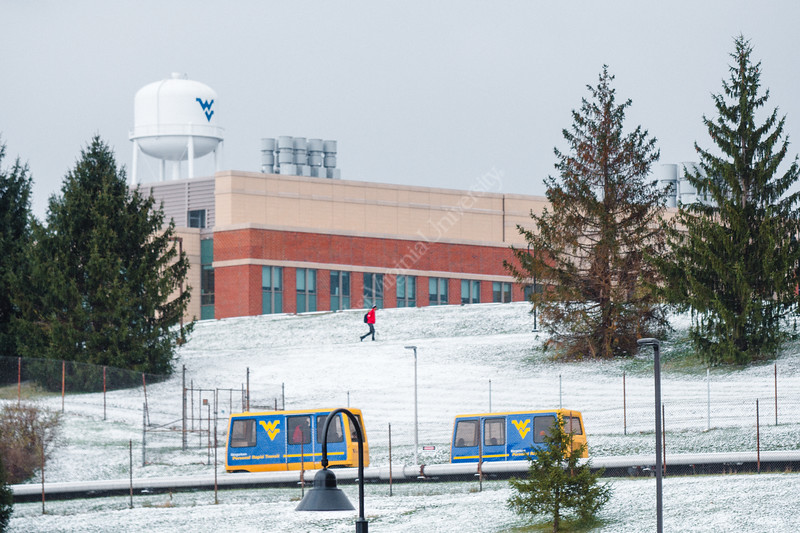 Two PRT cars travel across the Evansdale campus on a cold, snowy day.