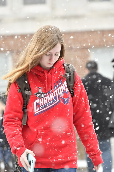 WVU students enjoy a snowy morning walk to classes on the downtown campus, making pictures and talking with friends. November 28, 2018. Photo Greg Ellis