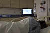 A patient recovers in the ICU in low warm light as part of research on how light at night impedes recovery from a stroke. Photo Greg Ellis