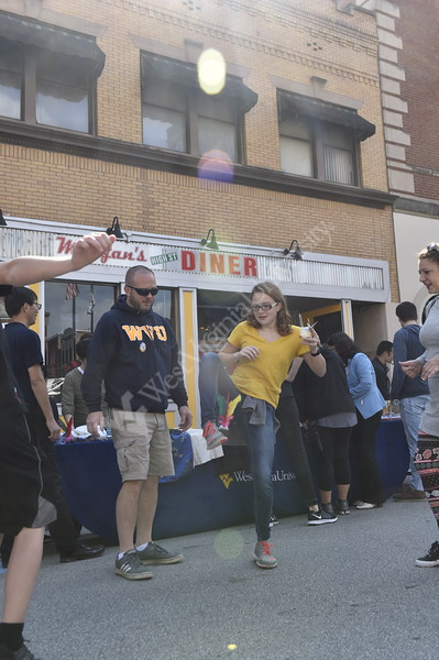 Students attend the annual International Street Fair on High Street in Morgantown on September 29, 2018.