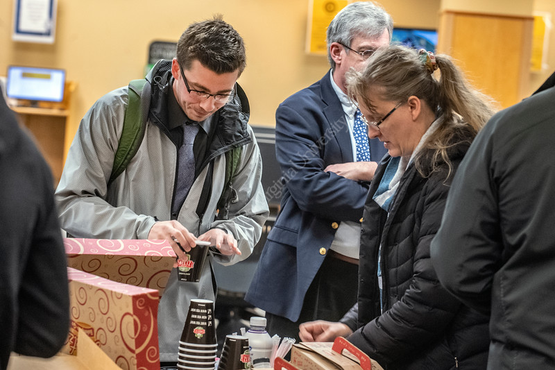 Members of the Office of the Provost and the Division of University Relations offer coffee and donuts to Philip Gibson, a Wildlife Management major at the Evansdale Library during a day long campus wide Research Celebration Friday April 5th, 2019.  Gibson usually stops in the library for coffee is on his way to present his research project at the Davis College.    Photo Brian Persinger