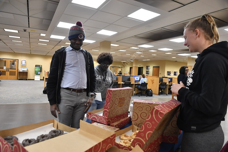Members of the Office of the Provost and the Division of University Relations offer coffee and donuts to staff, students and faculty at the Evansdale Library during a day long campus wide Research Celebration Friday April 5th, 2019. Photo Brian Persinger