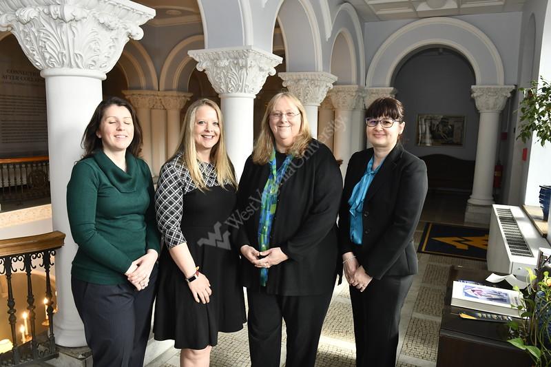 Sadie Bergeron, Geah Pressgrove, Cheryl McNeil and Ceresela Dinu pose for photographs in Stewart Hall April 8th, 2019.  Photo Brian Persinger
