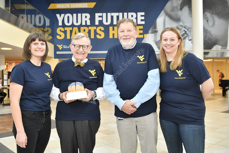 WVU President E. Gordon Gee poses with students and faculty at the Feed Our Brains event HSC April 17, 2019. Photo Greg Ellis