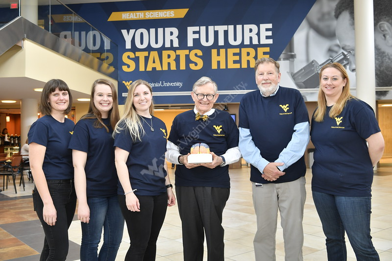 WVU President E.Gordon Gee poses with students and faculty at the Feed Our Brains event HSC April 17, 2019. Photo Greg Ellis