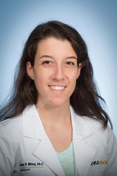 Anne Mittal, PA-C of the WVU Medicine Neurology department pose for a portrait at the HSC studio April 18, 2019. Photo Greg Ellis