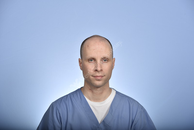 Andrew Novak, APRN-FNP of the WVU Medicine Neurology department pose for a portrait at the HSC studio Apri 18, 2019. Photo Greg Ellis