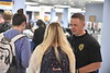 Members of the University Police Department and SGA pass out information and offer refective flying WV's as part of a Distracted Driver Awareness program in the Mountainlair April 24th, 2019.  Photo Brian Persinger