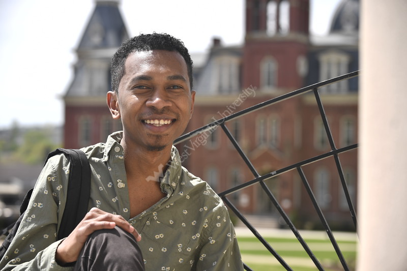 Natalino Soares poses for photographs on the downtown campus April 24th, 2019.  Photo Brian Persinger
