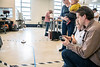 Andrew Palmer, a Mechanical Engineering major tests his hovercraft with his spouse Esther and children Peter and Owen during the WVU Demo Day in the Engineering Siences Building April, 25th 2019.  Photo Brian Persinger
