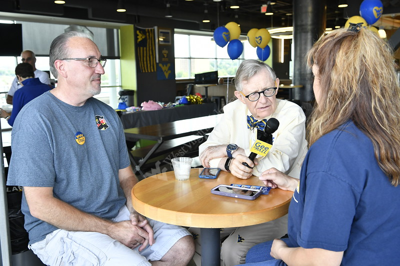 Incoming freshmen student parents interact with WVU President E Gordon Gee at the WVU Crossing as part of the Gee Mail, I Survived Move at the Parents' Reception. August 17, 2019. Photo Greg Ellis