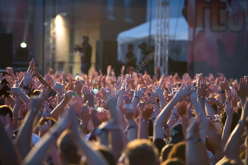 Students raise their hands during performance at Fall Fest on August 20, 2019. Photo Parker Sheppard