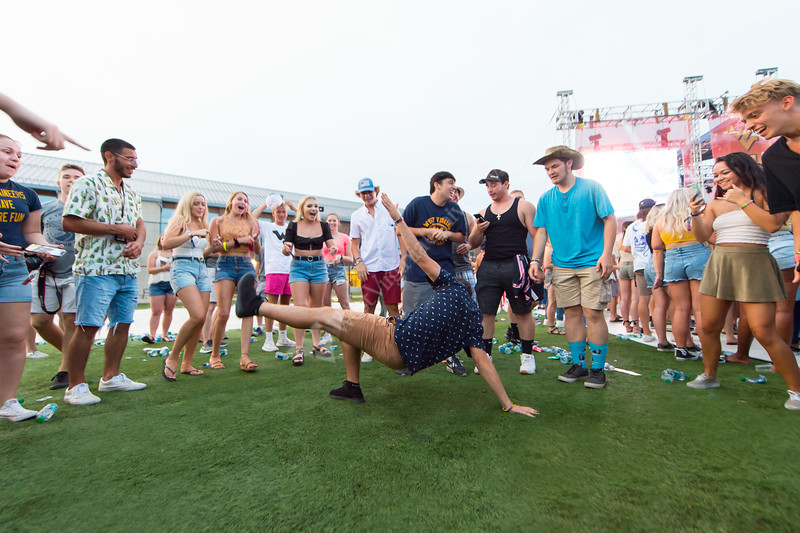 Students circle around and watch as a student dances at Fall Fest on August 20, 2019. Photo Parker Sheppard
