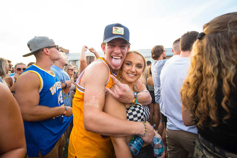 Two students pose for a picture in the crowd during Fall Fest on August 20, 2019. Photo Parker Sheppard