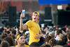 Students takes a selfie over the crowd during Fall Fest on August 20, 2019. Photo Parker Sheppard